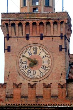 Clock tower on Piazza Maggiore in Bologna - part of a photoessay on the piazza