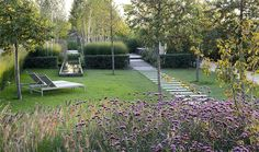 charming garden with long path and purple flowers | adamchristopherdesign.co.uk