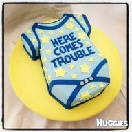 Here comes trouble baby boy onesie baby shower cake