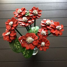 12 Michigan pine cone flowers attached to wooden stems. These unique one-of-a-kind flowers are not only beautifully hand-crafted but durable floral arrangements that you will enjoy year round. Painted red with white centers. Flower sizes range from 1 3/4 - 2 1/2 in diameter,