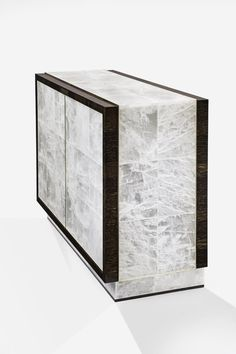 Buffets and cabinets ideas |a cabinet in gypsum, palmwood & gilt bronze,  |www.bocadolobo.com #interiordesign #decor #moderncabinets #buffetdeco