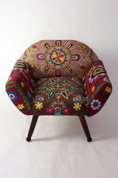 Wonderful embroidered Chair.... this would probably go in the corner of the library room, art room, maybe even playroom.