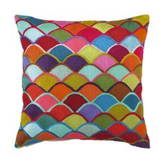 How great would this colorful fish scale pillow look on a neutral nursery glider?