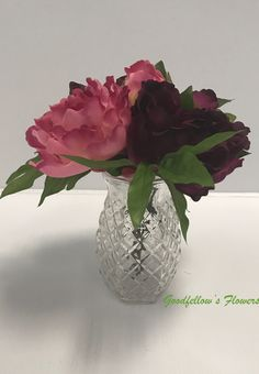 Lovely purple and dark pink peonies centerpiece in a crystal like vase. If you love this item or would like to have a custom piece made for you or your loved one, please contact us we would be happy to help! Peonies Centerpiece, Centerpieces, Vase, Pink Peonies, Floral Arrangements, Deep, Crystals, Purple, Flowers