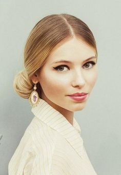 Try a sleek low bun for a sophisticated style.