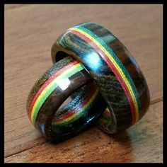 "Handmade Wood Rings These were designed by me and were supposed to be a size 5 & a size 10 but they came out just a touch too small on both. I had them remade.   Red, yellow & green rings are sandwiched between 2 different types of woods. The colors were chosen as a Vietnam War remembrance piece.  Absolutely unique and quite eye-catching.  5/16"" width on the size 5. 3/8"" width on the size 10.  Tag me with which size you would like to purchase. Handmade Jewelry Rings"