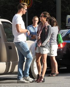 Hot couple: Alicia looked cute and casual in her shorts and Chelsea boots whilst her man rocked a white tee and jeans