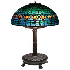 Tiffany Studios 'Pomegranate' Table Lamp | From a unique collection of antique and modern table lamps at https://www.1stdibs.com/furniture/lighting/table-lamps/