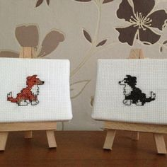 My cross stitch versions of my boys. The pattern is designed by Maria Diaz and I adapted the colours to match theirs!