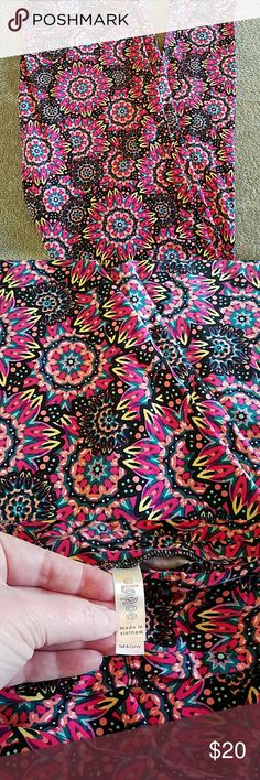 NWOT LuLaRoe TC Leggings I'm not a consultant, just went nuts buying leggings even though TC was a little snug on me. Kept thinking I'd lose enough weight to make them comfortable, but haven't yet. In the meantime they've just sat in my dresser. As much as I love some of these prints and hate to let them go, I would rather sell them so I can get some TC2 that fit me more comfortably. LuLaRoe Pants Leggings