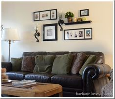 I love this picture arrangement. This site shows how to put an arrangement on your wall like this one.