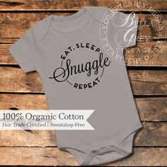 Eat, Sleep, Snuggle, Repeat Organic Knit Cotton Baby Bodysuit  Who doesnt love baby snuggles? Designed on extra soft and breathable mid-weight organic interlock cotton. Photos show natural bodysuit with onyx glitter design and storm bodysuit with black flocked design.  ORDERING: 1. Select your size and bodysuit color from the drop-down menus. 2. Enter the color youd like for your design in the notes to seller box at checkout. Choose from soft flocked velvet, glitter, or solid shades…