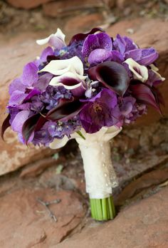 Brides.com: 20 Ways to Wrap a Wedding Bouquet. Layer Lace and Ribbon. This bride's favorite hue, eggplant purple, inspired her mostly monochromatic bouquet of violet orchids, hydrangea and Calla lilies. The stems were wrapped in a piece of lace layered over white ribbon.  See more photos from this outdoor wedding.