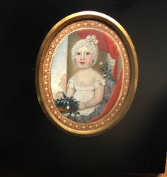 Wearing an elaborate white embroidered dress trimmed with rosettes at the shoulders and exquisite lace bonnet, clutching a basket of red white and blue flowers, landscape background with architectu. White And Blue Flowers, Red And White, White Embroidered Dress, Miniature Portraits, Holding Flowers, Landscape Background, Kids Seating, Tiny Treasures, Miniture Things