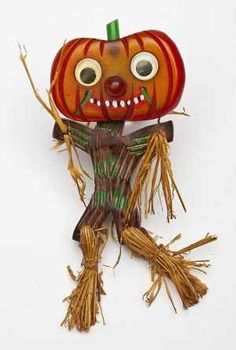 super rare Bakelite Pumpkin head on wood and straw scarecrow body - sold for $5000 in 2011 at Antique Trader