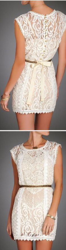 Gives new meaning to short lace dress. Details are stunning! Can't find source.