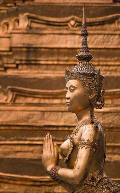 Bangkok, statue of Kinnaree, the mystical creature @ the temple of the Emerald Buddha.