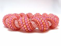 Peachy Dream Beadwoven Cellini Spiral Bangle by littlestonedesign, $59.00