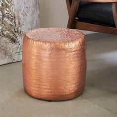 This table, with its copper colour and curved age lines, appears to be a table fashioned out of polished rock. It will make a great addition to any room in your home.