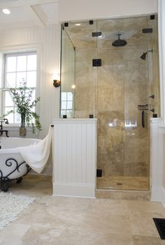 I like the beadboard with this color of flooring with the black accents on the tub.