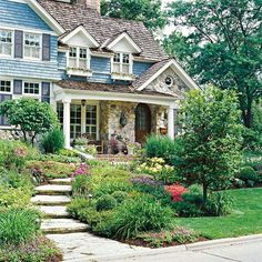 Front Yard Garden Design front yard ideas - plant all the way out front. This blue home is beautiful. this looks nice. - Do you want a front yard with more curb appeal? Look to your house for design inspiration! Front Yard Garden Design, Front Yard Landscaping, Landscaping Ideas, Landscaping Software, Design Tropical, Flagstone Path, Stone Facade, Deco Design, Design Design