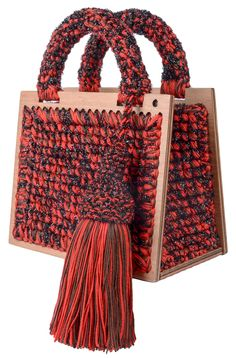 Red, brown and sparkly black hand woven small 'St. Barts' purse with removable black strap and tassel, inside pocket, handles, plywood bottom and frames. 100% microfiber acrylic 100% metallic lurex Height: 16.0 cm Width: 20.0 cm Depth: 10.0 cm In case of preorder, the item will be shipped in ten days after the payment has been processed. Handmade in Georgia