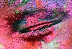 """""""The eye of a student, smeared in colors, is seen during the celebrations of the Holi, in Chandigarh, India"""" on March 10, 2009. REUTERS / Ajay Verma"""