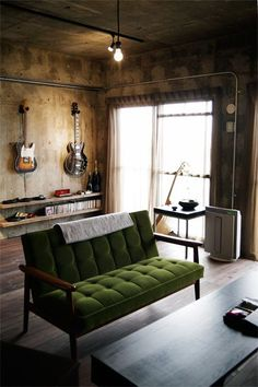 Rocking industrial bachelor pad living space. Love the mounted guitars.