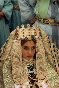 Africa | Morocco. Fez. Young bride wearing gold braided robe. Fezzi wedding are considered as the most elaborated. 1984.   | © Bruno Barbey.