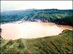 1986: Hundreds gassed in Cameroon lake disaster At least 1,200 people are feared dead in Cameroon, West Africa, after a cloud of lethal gas escaped from a volcanic lake. The tragedy happened at Lake Nyos, about 200 miles (322 km) northwest of the capital, Yaoundé, during the night.  Most of the victims died in their sleep.