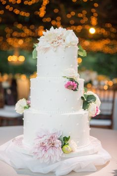 Gorgeous dahlia topped wedding cake: http://www.stylemepretty.com/california-weddings/rutherford/2016/06/02/once-upon-a-time-this-napa-valley-wedding-escaped-from-a-fairytale/ | Photography: Lori Paladino Photography - http://loriphoto.com/br