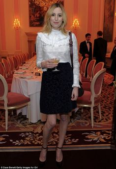 Quite a sight: Not to be outdone, Laura – best known for her breakout role on ITV drama Downton Abbey – looked suitably elegant in a loose fitting white Victoriana blouse