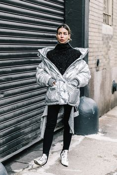 Street Style_metallic puff worn over roll neck sweater paired with skinnies and metallic ankle boots | Saved by Gabby Fincham |