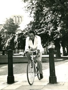 Richard Burton rides a bike.