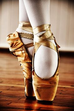 Golden pointe shoes.