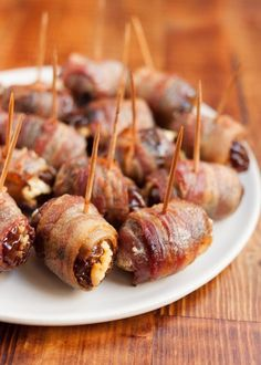 Bacon-Wrapped Dates stuffed with your favorite cheese...goat, blue, parm., etc. Roll in brown sugar or maple syrup for extra sweetness. Just Yummy!