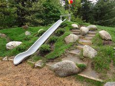 Playground design - build 'steps' into hill