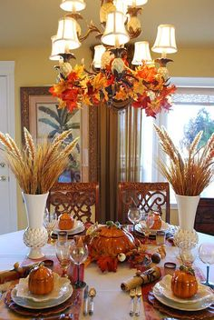 Thanksgiving- Beautiful table! I love the leaves in the light fixture.