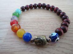 Check out this item in my Etsy shop https://www.etsy.com/listing/216239219/chakra-buddha-evil-eye-bracelet-life