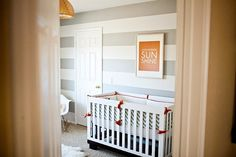 Love this simple boy nursery - gray orange and blue
