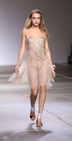 Cara Delevingne leads glamour at Topshop show for London Fashion Week #dailymail