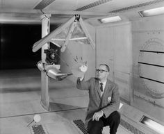 "W. C. Sleeman, Jr. inspecting a model of the paraglider in 300 mph 7 x 10 Foot Wind Tunnel. The paraglider, or ""Rogallo Wing,"" was proposed for use in the Gemini Program. It would have allowed Gemini to make precision landings on land, rather than in the water. But the wing suffered a number of problems. The biggest problem was getting it to deploy properly and reliably. The plan was canceled."
