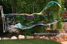 """Super giant bubbles are addicting to young and old. Here is a tutorial on how- to make your own """"Super Giant Bubbles Kit"""". Kids would love to receive this as a gift or even help make the kit. I made the simple drawstring sack to hold the bubble kit supplies. The bubble recipe is..."""