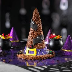 So cute, and I LOVE RICE KRISPIES! Shape chocolate Rice Krispies Treats into a large witch's hat for a fun and festive centerpiece for your Halloween party's snack table. Holiday Treats, Halloween Treats, Holiday Recipes, Halloween Party, Halloween Goodies, Happy Halloween, Halloween Stuff, Holiday Foods, Holiday Fun