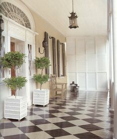 Painted diagonal checkerboard floor on a shuttered porch... southern perfection.