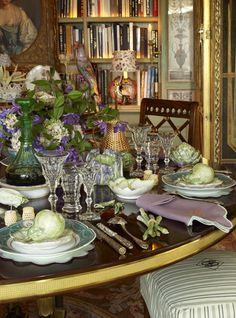 Howard Slatkin NY dining room, from FIFTH AVENUE STYLE.  Russian dinner plates from service of Alexander I yacht, Livadia.  Porcelain pears, by Vladimir Kanevsky, contain coddled egg with caviar. Photo by Tria Giovan