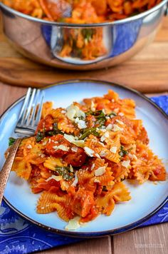 Serve pasta for dinner with the delicious flavours in this super quick Sausage, Tomato and Spinach Pasta - a perfect family meal. - Gluten free, dairy free, vegetarian, Slimming World and Weight Watchers friendly