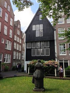 This is one of the only original wooden buildings in Amsterdam that survived a big fire or two, and a few hundred years of being in the middle of a city. Love those original leaded windows.