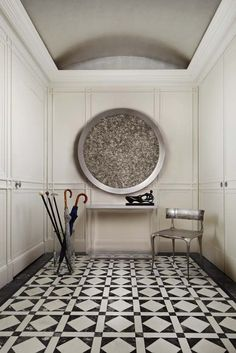 Entry hall in NYC apartment with  black white tile floors | Designed by Bradfield & Tobin