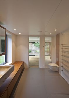 Concrete basin, walnut furniture and resin floor